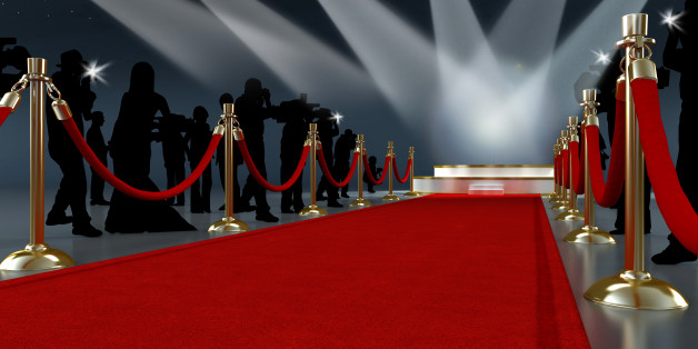 Movie night concept with spotlights, red carpet, gold barriers, velvet ropes and paparazzis... High resolution 3D render.