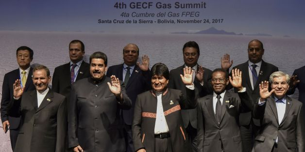 (L to R front)Iranian Vice-President Eshaq Yahanguiri, Venezuelan President Nicolas Maduro, Bolivian President Evo Morales, Equatorial Guinea's President Teodoro Obiang and Mohammad Hossein Adeli, general secretary of Gas Exporting Countries Forum waves during the family picture of the IV Gas Exporting Countries Summit in Santa Cruz de la Sierra, Bolivia on November 24, 2017. / AFP PHOTO / AIZAR RALDES        (Photo credit should read AIZAR RALDES/AFP/Getty Images)