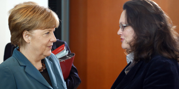 German Chancellor Angela Merkel (L) listens to Labour Minister Andrea Nahles during a cabinet meeting at the Chancellery in Berlin April 30, 2014.   REUTERS/Fabrizio Bensch (GERMANY - Tags: POLITICS)
