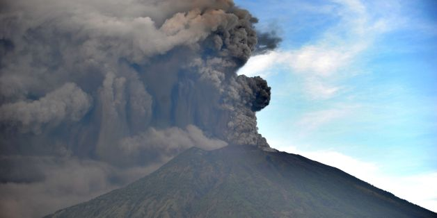 General view of Mount Agung during an eruption seen from Kubu sub-district in Karangasem Regency, on Indonesia's resort island of Bali on November 26, 2017. Mount Agung belched smoke as high as 1,500 metres above its summit, sparking an exodus from settlements near the mountain. / AFP PHOTO / SONNY TUMBELAKA        (Photo credit should read SONNY TUMBELAKA/AFP/Getty Images)
