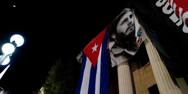 A giant poster of late former president Fidel Castro hangs on a building at the University of Havana to commemorate the first anniversary of his death, on November 25, 2017.On November 25 Cuba commemorates the first anniversary of the death of Fidel Castro, during an electoral process that will bring a change in president against a backdrop of economic recession, hostility from the United States, and stagnation in the reforms that have been implemented. / AFP PHOTO / ADALBERTO ROQUE        (Phot