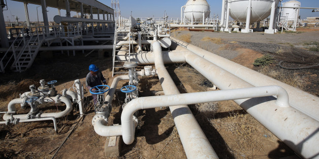 An Iraqi oil employee checks pipelines at the Bai Hassan oil field, west of the multi-ethnic northern Iraqi city of Kirkuk, on October 19, 2017.Kurdish peshmerga forces withdrew without a fight after federal government troops and militia entered Kirkuk, seizing the provincial governor's office and key military bases in response to a Kurdish vote for independence in September 2017. / AFP PHOTO / AHMAD AL-RUBAYE        (Photo credit should read AHMAD AL-RUBAYE/AFP/Getty Images)