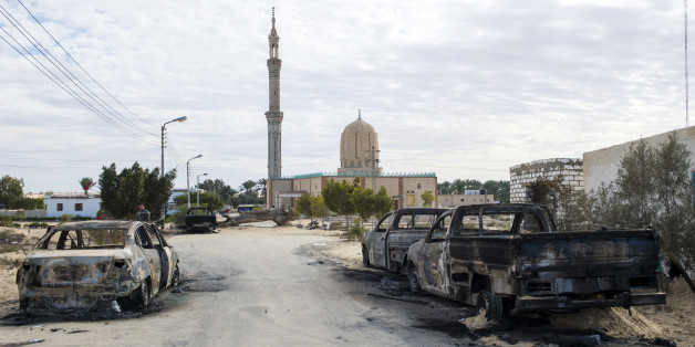 TOPSHOT - A picture taken on November 25, 2017, shows the Rawda mosque, roughly 40 kilometres west of the North Sinai capital of El-Arish, after a gun and bombing attack.Armed attackers killed at least 235 worshippers in a bomb and gun assault on the packed mosque in Egypt's restive North Sinai province, in the country's deadliest attack in recent memory.   / AFP PHOTO / STR        (Photo credit should read STR/AFP/Getty Images)