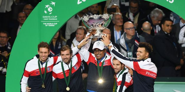 (From top L) France's Nicolas Mahut, Julien Benneteau, Yannick Noah, Richard Gasquet and Jo-Wilfried Tsonga pose with the trophy after winning the Davis Cup World Group final tennis match between France and Belgium at The Pierre Mauroy Stadium in Villeneuve d'Ascq near Lille on November 26, 2017.  / AFP PHOTO / Denis Charlet        (Photo credit should read DENIS CHARLET/AFP/Getty Images)
