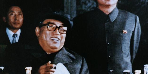 NORTH KOREA:File photo released by the Korea News Service dated October 1980 shows North Korean leader Kim Jong-Il (R) and father Kim Il-Sung (front), attending an evening party to celebrate the 6th Korean Worker's Party convention.  Kim Jong-Il was re-elected as head of the country's powerful National Defense Commission, Pyongyang Radio said 05 September, as CNN reported the title of president had been abolished in defense to Kim Il-Sung's father who died in 1994, leaving Kim Il-Sung as effecti