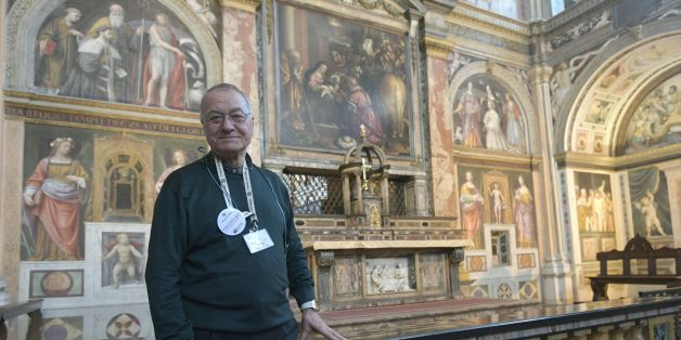 Syrian born Mohamed Hamadi poses in the church of San Maurizio al Monastero Maggiore, on November 15, 2017 in central Milan. Mohamed Hamadi who is retired is part of volunteers that guide visitors in this catholic church.  / AFP PHOTO / Miguel MEDINA        (Photo credit should read MIGUEL MEDINA/AFP/Getty Images)