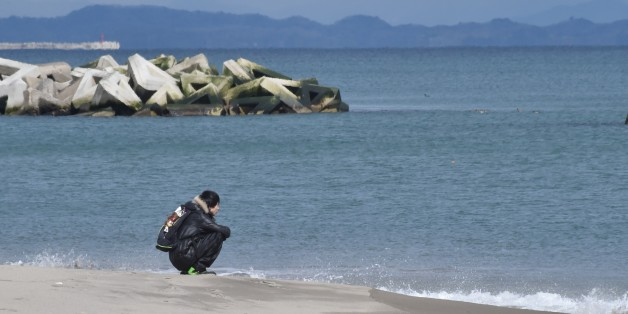 A man visits the seashore in Sendai's Arahama area, Miyagi prefecture on March 11, 2017 to pray for victims of the 2011 quake-tsunami disaster.