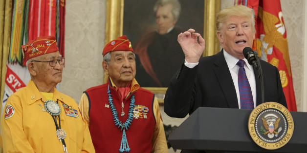 WASHINGTON, DC - NOVEMBER 27: (AFP OUT) U.S. President Donald Trump (R) speaks during an event honoring members of the Native American code talkers in the Oval Office of the White House, on November 27, 2017 in Washington, DC. Trump stated, 'You were here long before any of us were here. Although we have a representative in Congress who they say was here a long time ago. They call her Pocahontas.' in reference to his nickname for Sen. Elizabeth Warren. (Photo by Oliver Contreras-Pool/Getty Image
