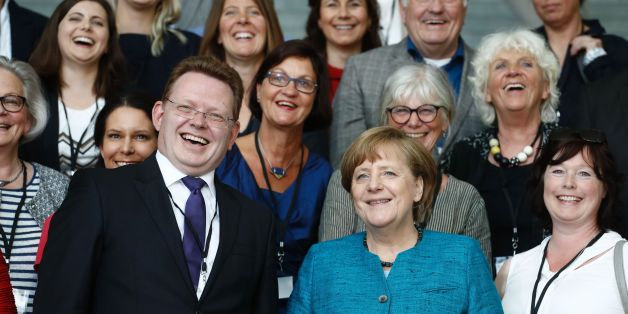 German Chancellor Angela Merkel (C-R) poses with Altena's mayor Andreas Hollstein (C-L) and other winners of the national integration award at the Chancellery in Berlin on May 17, 2017. / AFP PHOTO / Odd ANDERSEN        (Photo credit should read ODD ANDERSEN/AFP/Getty Images)