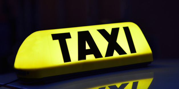 Illuminated yellow Taxi signIlluminated yellow Taxi sign