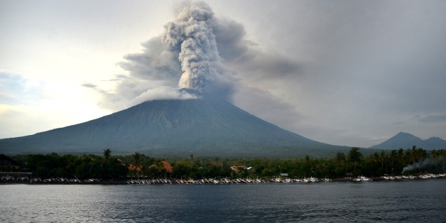 A general view shows Mount Agung erupting seen from Kubu sub-district in Karangasem Regency on Indonesia's resort island of Bali on November 28, 2017. Indonesian authorities extended the closure of the international airport on the resort island of Bali for a second day over fears of a volcanic eruption. / AFP PHOTO / SONNY TUMBELAKA        (Photo credit should read SONNY TUMBELAKA/AFP/Getty Images)