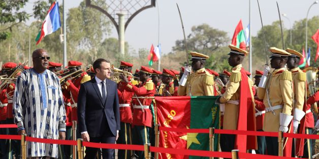 French President Emmanuel Macron (R) and Burkina Faso's President Roch Marc Christian Kabore review an honour guard at the Presidential Palace in Burkina Faso on November 28, 2017. / AFP PHOTO / POOL / LUDOVIC MARIN        (Photo credit should read LUDOVIC MARIN/AFP/Getty Images)
