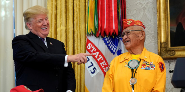 U.S. President Donald Trump reacts as he honours Navajo Code Talkers for their contributions during World War Two at the White House in Washington, U.S., November 27, 2017.  REUTERS/Kevin Lamarque
