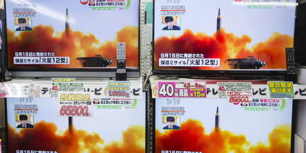 Televisions being sold at an Onoden Co. electronics store display a broadcast of a news report on North Korea's Nov. 29 missile launch, showing footage captioned as the launch of the Hwasong-12 missile in September, in Tokyo, Japan, on Wednesday, Nov. 29, 2017. North Korean leader Kim Jong Un said his regime completed its nuclear program after firing a missile that put the entire U.S. in range. Photographer: Keith Bedford/Bloomberg via Getty Images