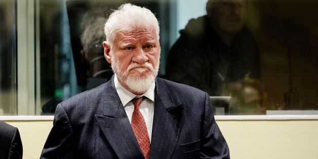 Croatian former general Slobodan Praljak stands prior to the start of his appeal judgement at the International Criminal Tribunal for the former Yugoslavia (ICTY) on November 29, 2017 at the Hague international court, in the court's final verdict for war crimes committed during the break-up of Yugoslavia. 