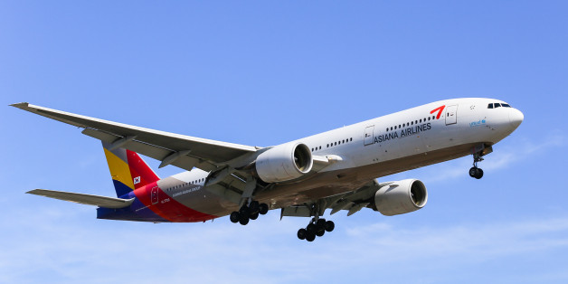 Los Angeles, USA - May 30, 2015: An airplane of Asiana Airlines (Boeing 777-200) landing at Los Angeles International Airport.