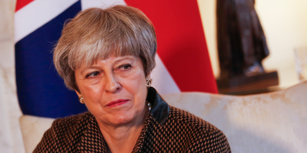 Theresa May, U.K. prime minister, pauses during her bilateral meeting with Binali Yildirim, Turkey's prime minister, inside number 10 Downing Street in London, U.K., on Monday, Nov. 27, 2017. May has a week to find a compromise on the conflicting Brexit demands from the north and south of Ireland, just as a political scandal threatening the Irish government could further undermine her chances of success. Photographer: Luke MacGregor/Bloomberg via Getty Images