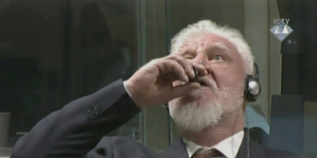 A wartime commander of Bosnian Croat forces, Slobodan Praljak, is seen during a hearing at the U.N. war crimes tribunal in the Hague, Netherlands, November 29, 2017. ICTY via REUTERS TV ATTENTION EDITORS - THIS IMAGE WAS PROVIDED BY A THIRD PARTY.     TPX IMAGES OF THE DAY