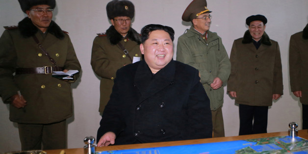 North Korea's leader Kim Jong Un is seen as the newly developed intercontinental ballistic rocket Hwasong-15's test was successfully launched, in this undated photo released by North Korea's Korean Central News Agency (KCNA) in Pyongyang November 30, 2017. REUTERS/KCNA ATTENTION EDITORS - THIS IMAGE WAS PROVIDED BY A THIRD PARTY. REUTERS IS UNABLE TO INDEPENDENTLY VERIFY THIS IMAGE. SOUTH KOREA OUT. NO THIRD PARTY SALES. NOT FOR USE BY REUTERS THIRD PARTY DISTRIBUTORS