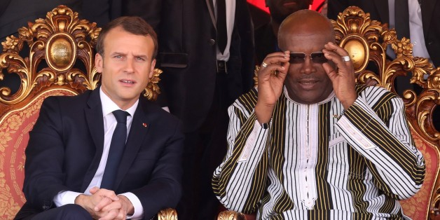 French president Emmanuel Macron (L) speaks with Burkina Faso's President Roch Marc Christian Kabore attend the inauguration ceremony of the solar energy power plant in Zaktubi, near Ouagadougou, on november 29, 2017, on the second day of his first African tour since taking office. / AFP PHOTO / POOL / LUDOVIC MARIN        (Photo credit should read LUDOVIC MARIN/AFP/Getty Images)