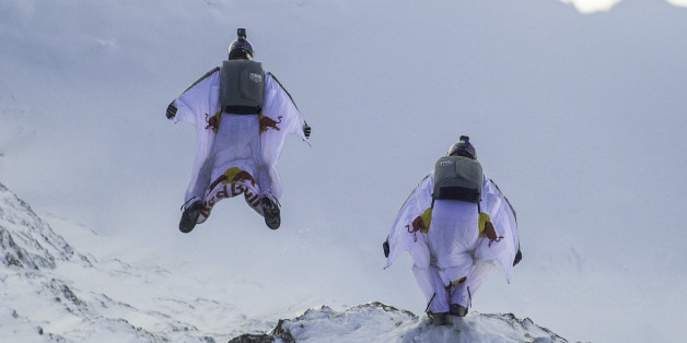 LAUTERBACH, SWITZERLAND - OCTOBER 13: In this handout image provided by Red Bull, wingsuit flyers Fred Fugen and Vince Reffet, known as the Soul Flyers, catching up and fly into a Pilatus Porter plane, piloted by Philippe Bouvier, in mid air after jumping off the Jungfrau mountain on October 13, 2017 in Lauterbach, Switzerland. After B.A.S.E. jumping from the 4,158 meters high mountain the French athletes had 2.45 minutes and a free fall distance of 3,200 meters to complete their project 'Door I