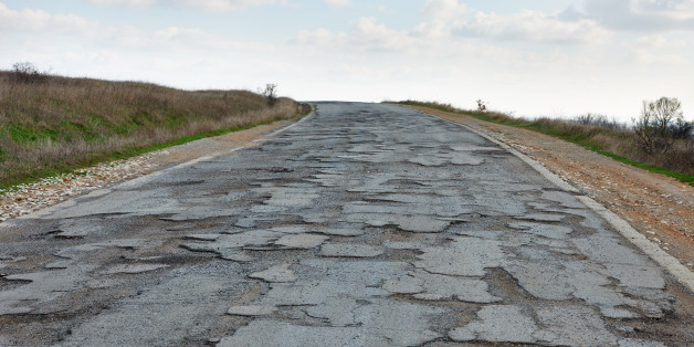 Very bad condition damaged road that needs repair