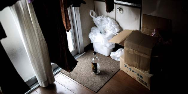 This picture taken on June 21, 2017, shows a bottle of whisky in the kitchen of a woman who died alone and left for about two weeks, in her apartment in Yokohama.There are no official data for the number of people dying alone who stay unnoticed for days and weeks but most experts estimate it at 30,000 per year in Japan. A Japanese woman in her 30s, who suffered alcoholism and has been hospitalised for a mental illness, died alone in an apartment in Yokohama and her body was not discovered for ne