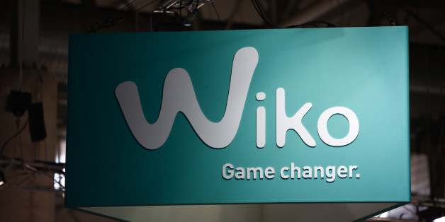 A Wiko logo sits on display in the Wiko pavilion at the Mobile World Congress in Barcelona, Spain, on Tuesday, March 3, 2015. The event, which generates several hundred million euros in revenue for the city of Barcelona each year, also means the world for a week turns its attention back to Europe for the latest in technology, despite a lagging ecosystem. Photographer: Simon Dawson/Bloomberg via Getty Images