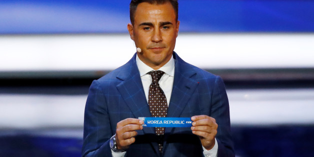 Soccer Football - 2018 FIFA World Cup Draw - State Kremlin Palace, Moscow, Russia - December 1, 2017   Fabio Cannavaro pulls out Korea Republic during the draw   REUTERS/Kai Pfaffenbach