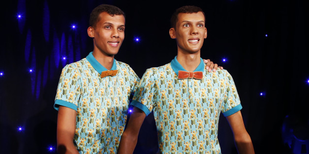 Belgian singer Stromae stands next to  his figure at the Grevin wax museum during the presentation of his waxwork in Paris October 12, 2014. REUTERS/Benoit Tessier (FRANCE - Tags: ENTERTAINMENT SOCIETY)