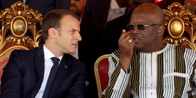 French President Emmanuel Macron and Burkina Faso's President Roch Marc Christian Kabore attend the inauguration ceremony of the solar energy power plant in Zaktubi, near Ouagadougou, Burkina Faso, November 29, 2017.   REUTERS/Ludovic Marin/Pool