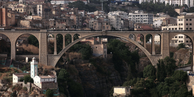 People cross over a bridge in the eastern city of Constantine June 21, 2012.       REUTERS/Zohra Bensemra (ALGERIA - Tags: CITYSPACE)