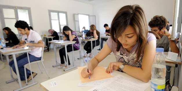 Tunisian students take the baccalaureat (high school graduation exam) exam on June 6, 2012 in Tunis. Some 129 181 candidates registered for the main session of the baccalaureat held this year from June 6 to 13. The average female candidates stood at 57.06% against 42% for boys. The Bachelor 2012 will be marked by the application of an adult aged 64 years and five students who are serving a prison sentence. The exam results will be announced on June 23, 2012. AFP PHOTO / FETHI BELAID        (Phot