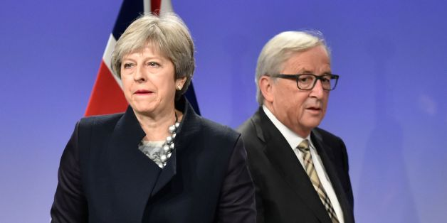 British Prime Minister Theresa May (L) and European Commission chief Jean-Claude Juncker give a press conference as they meet for Brexit negotiations on December 4, 2017 at the European Commission in Brussels. British Prime Minister Theresa May meets European Commission chief Jean-Claude Juncker on December 4 as an 'absolute' deadline to reach a Brexit divorce deal expires. / AFP PHOTO / JOHN THYS        (Photo credit should read JOHN THYS/AFP/Getty Images)