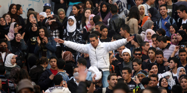 Algerian secondary schools students shout slogans during a protest held in front of a local school in the center of Algiers, 20 January 2008. Students demonstrated in major cities across Algeria to protest against the heavy workload required for the high school graduation exam at the end of the year.  AFP PHOTO/FAYEZ NURELDINE        (Photo credit should read FAYEZ NURELDINE/AFP/Getty Images)