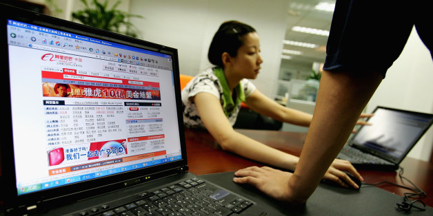 BEIJING - AUGUST 12: Wendy Li, vice director of business development department of Ali Baba works at the office of Alibaba (China) technology Co., Lth on August 12, 2005 in Beijing, China.  Yahoo Inc. signed a deal to buy 40 percent of Alibaba.com for EUS 1 billion cash while handing over the running of its China operations to the Chinese online retailer in the biggest investment by a foreign company to gain access to China's 100 million net users. The deal creates an e-commerce giant, with the