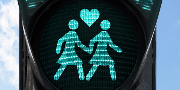 traffic light with gay theme - two women holding hands.