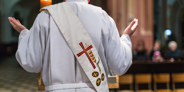 Priest during a ceremony in a church, celebrating a mass
