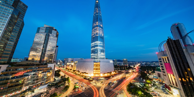 Cityscape of Songpagu district in Seoul at night. Motion blurred traffic lights, illuminated skyscrapers and Lotte world tower. Seoul, South Korea, Asia. Aerial view with 10 mm ultra wide angle 42 MP Sony A7RII.