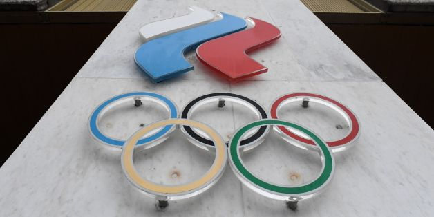 The Olympic rings are seen on the facade of the Russian Olympic Committee (ROC) building in Moscow on December 05, 2017.The International Olympic Committee (IOC) meets from Tuesday, December 5, 2017 to decide whether to bar Russia from the 2018 Winter Olympics for doping violations, in one of the weightiest decisions ever faced by the Olympic movement. / AFP PHOTO / Kirill KUDRYAVTSEV        (Photo credit should read KIRILL KUDRYAVTSEV/AFP/Getty Images)