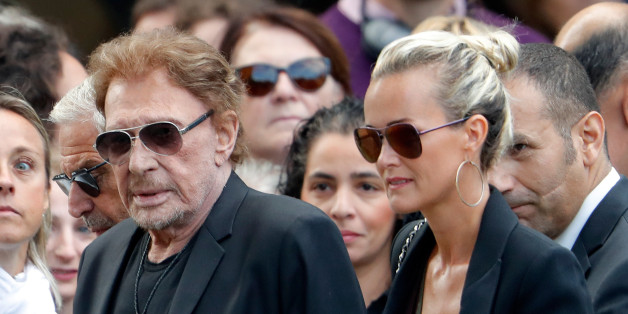 French singer and actor Johnny Hallyday (L) and his wife Laeticia attend the funeral ceremony of late actress Mireille Darc at the Saint-Sulpice church in Paris, France, September 1, 2017. REUTERS/Charles Platiau