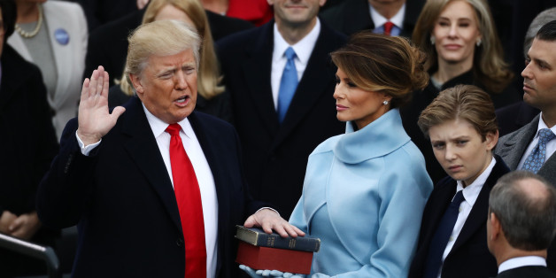 U.S. President-elect Donald Trump takes the oath of office as First Lady-elect Melania Trump stands during the 58th presidential inauguration in Washington, D.C., U.S., on Friday, Jan. 20, 2017. Donald Trump will become the 45th president of the United States today, in a celebration of American unity for a country that is anything but unified. Photographer: Andrew Harrer/Bloomberg via Getty Images