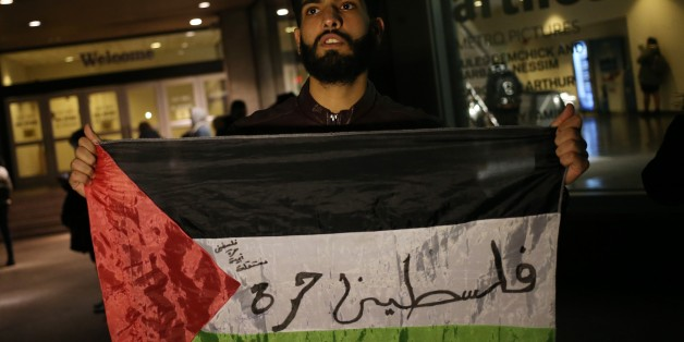 NEW YORK, USA - DECEMBER 6 : A student holds a Palestinian flag during a protest against the US President Donald Trumps recognition of Jerusalem as Israels capital, in Manhattan borough of New York, United States on December 6, 2017. (Photo by Mohammed Elshamy/Anadolu Agency/Getty Images)