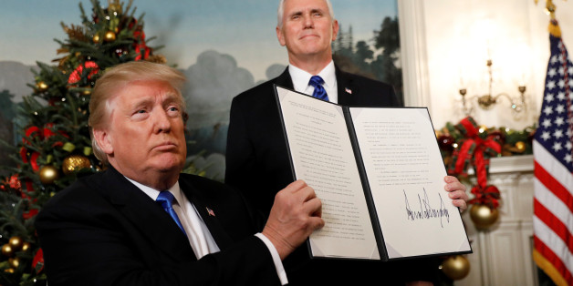 After signing, U.S. President Donald Trump holds up the proclamation that the United States recognizes Jerusalem as the capital of Israel and will move its embassy there, during an address from the White House in Washington, U.S., December 6, 2017.  REUTERS/Kevin Lamarque