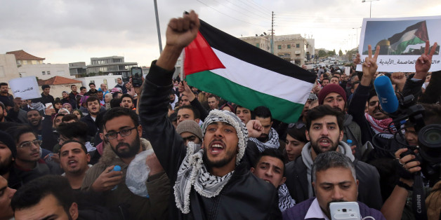 Protesters shout slogans and wave the Jordanian flag during a protest near the American Embassy in Amman against US President Donald Trump's decision to recognise Jerusalem as the capital of Israel on December 7, 2017.   / AFP PHOTO / KHALIL MAZRAAWI        (Photo credit should read KHALIL MAZRAAWI/AFP/Getty Images)