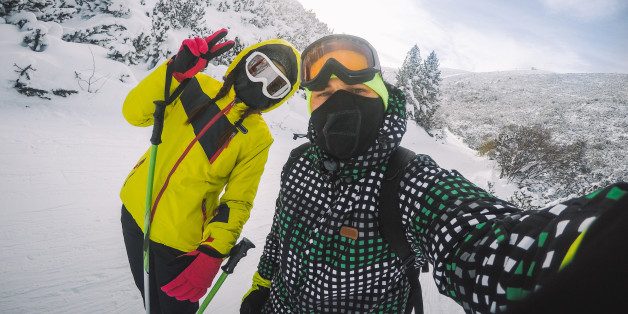 Skiers on the mountain, enjoying in skiing and making selfie