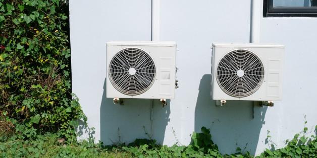 Air conditioner condenser unit at a concrete wall