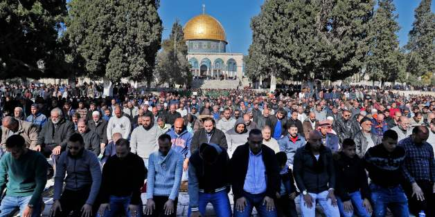 Palestinian Muslim worshippers pray in front of the Dome of the Rock mosque at the al-Aqsa mosque compound in the Jerusalem's Old City on December 8, 2017. Israel deployed hundreds of additional police officers following Palestinian calls for protests after the main weekly Muslim prayers against US President Donald Trump's recognition of Jerusalem as Israel's capital. / AFP PHOTO / Ahmad GHARABLI        (Photo credit should read AHMAD GHARABLI/AFP/Getty Images)