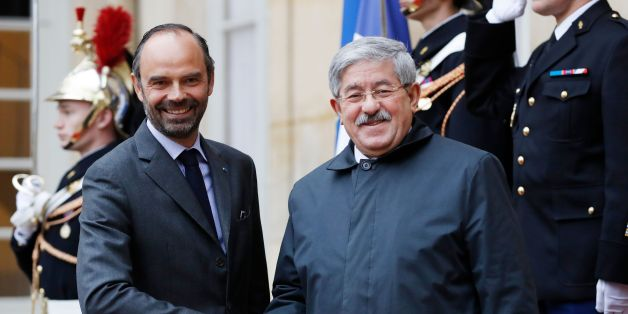 French Prime Minister Edouard Philippe (L) welcomes his Algerian counterpart Ahmed Ouyahia before a meeting at the Hotel Matignon in Paris on December 7, 2017.   / AFP PHOTO / Patrick KOVARIK        (Photo credit should read PATRICK KOVARIK/AFP/Getty Images)
