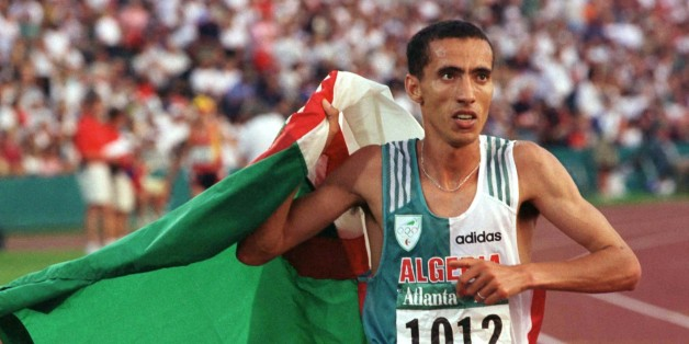 Noureddine Morceli carries the Algerian flag in a victory lap as he celebrates his gold medal win in the Men's 1500m final at Olympic Stadium August 3. Fermin-Cacho of-Spain won the silver medal and Stephen-Kipkorir won the bronze.